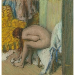 Nude woman wiping her left feet. A woman at her toilet