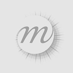 Woman sitting on the floor, combing her hair