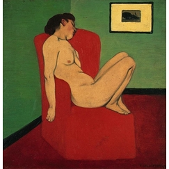 Naked woman sitting in a red armchair