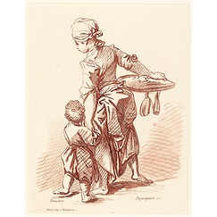 Woman holding a child by the hand